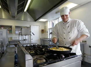 one of our chefs preparing lunch